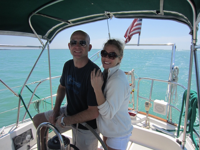 Annie and Philip sailing Traveler's Rest (Let's be honest though...Phillip is the skipper)